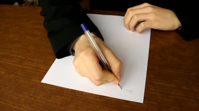 stock-footage-man-writing-a-formal-letter-to-the-president-close-up-white-sheet-of-paper